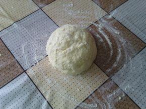 Снимка 2 от рецепта за Пухкави сиренки с масло