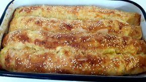 Снимка 7 от рецепта за Вкусни банички със сирене