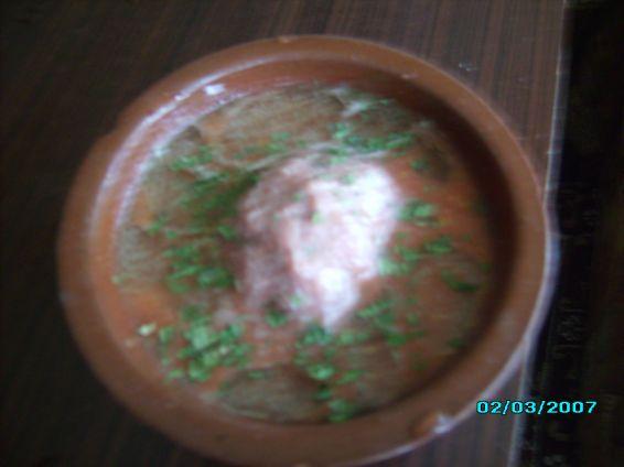 Снимка 2 от рецепта за Скрити яйчица в доматен сос