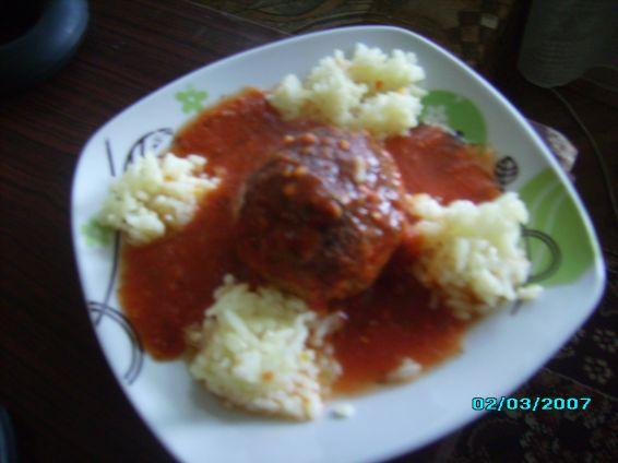 Снимка 4 от рецепта за Скрити яйчица в доматен сос