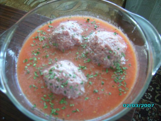Снимка 5 от рецепта за Скрити яйчица в доматен сос